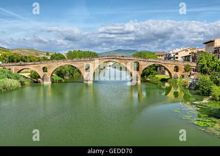 Ancient roman bridge across the Arga river in Puente la Reina, near Pamplona, Navarra, Spain - Stock Photo