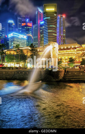 Singapore, Singapore - March 1, 2016: Merlion statue spraying the water from its mouth at Merlion Park in Downtown - Stock Photo