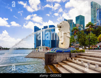 Singapore, Singapore - March 1, 2016: Merlion statue spraying the water from the mouth at Merlion Park in Downtown - Stock Photo