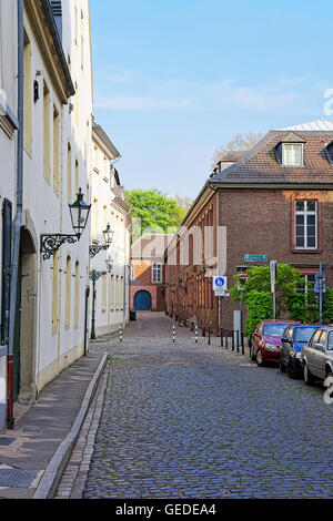 Dusseldorf, Germany - May 3, 2013: Tiny street in the Old city center of Dusseldorf in Germany. It is the capital of Rhine Westphalia region. Stock Photo