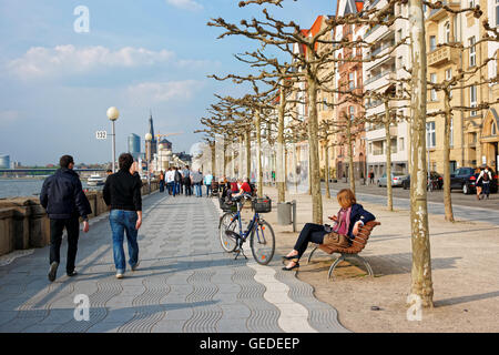 Dusseldorf, Germany - May 3, 2013: Rhine embankment promenade in the Old city center in Dusseldorf in Germany. Tourists nearby. It is the capital of Rhine Westphalia region. Stock Photo