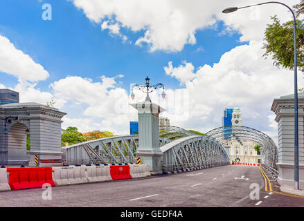 Singapore, Singapore - March 1, 2016: Anderson Bridge over Singapore River. Skyscrapers on the background. - Stock Photo