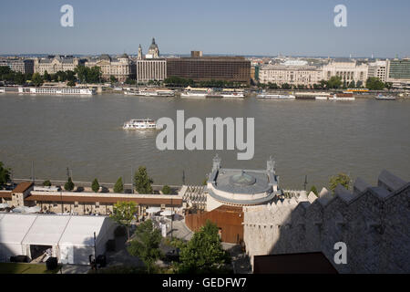 view east from Buda castle over walled cafe to Jane Haining rakpart - Stock Photo