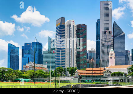 Singapore, Singapore - March 1, 2016: Skyline with One Raffles Place and UOB Building with Victoria Theater and - Stock Photo