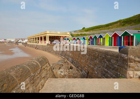 Whitmore Bay, Pavillion and beach huts, at Barry Island, South Wales, UK - Stock Photo
