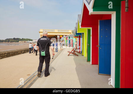 A medic on site at Whitmore Bay beach huts at Barry Island, South Wales, UK - Stock Photo