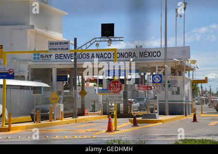 Vehicles exit the inspection station in Naco, Sonora, Mexico, and head north to enter the Naco, Arizona, USA. - Stock Photo