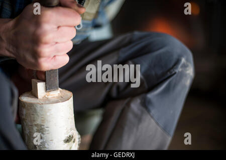 Hand of Woodworker using Chisel on Piece of Wood - Stock Photo