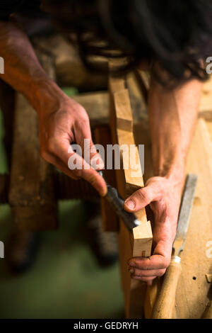 Woodworker Using Chisel on Piece of Wood, High Angle View - Stock Photo