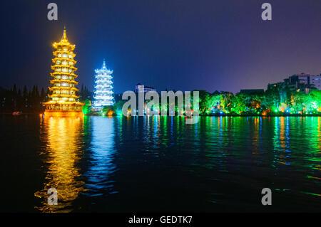 The Sun and Moon pagodas on Fir (Shanhu) Lake, Guilin, Guangxi Autonomous Region, China - Stock Photo