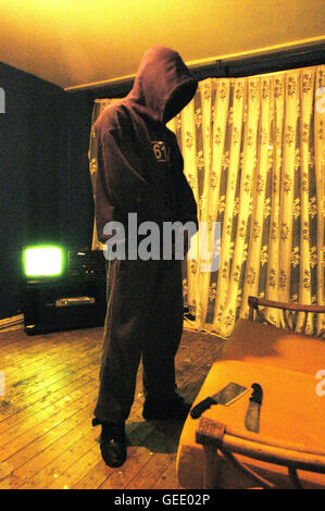 A member of the 'Muslim Boys' gang pictured in a safe house in Peckham, South London. 28.01.05 - Stock Photo