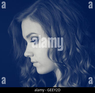 Profile of beautiful young woman - Stock Photo