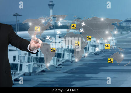 Businessman working with virtual interface to control connection networks of airplanes on their destination routes. - Stock Photo