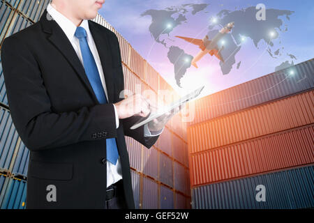 Businessman press digital tablet to show global network partnership connection use for logistic,import,export background. - Stock Photo