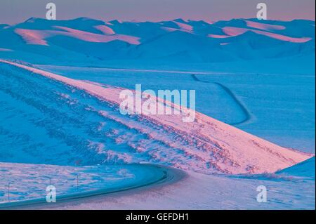 geography / travel, Canada, Yukon Territory, View down the Dempster Highway leading towards the Richardson Mountains in winter,