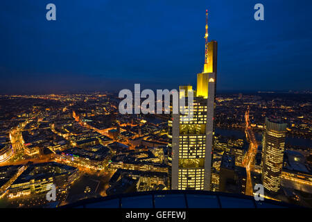 geography / travel, Germany, Hesse, Frankfurt am Main, Commerzbank Tower illuminated with yellow lights at dusk - Stock Photo