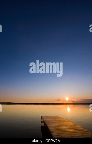 geography,travel,Canada,Manitoba,Wasagaming,Sunset over a wooden wharf (pier) Lake Audy,Riding Mountain National - Stock Photo