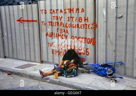 Homeless beggar with child. Athens. Greece. Europe - Stock Photo