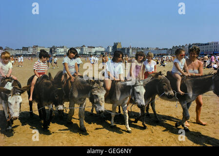 Donkey rides on Margate beach. Kent. England. Circa 1980's - Stock Photo