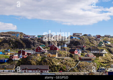 Typical colourful wooden houses on hillside seen from the port in summer 2016. Sisimiut (Holsteinsborg), Qeqqata, - Stock Photo