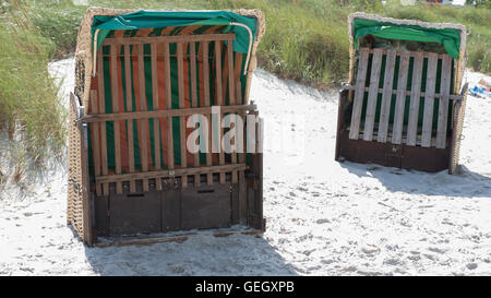 beach chairs on the baltic sea waiting to be rent - Stock Photo