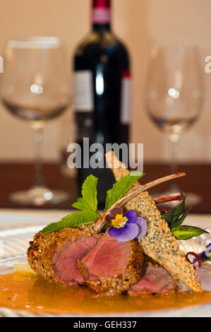 Lamb chops with red wine bottle - Stock Photo