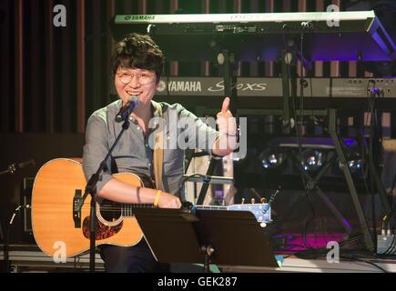 Baek Ja (The Group Woorinara), Jul 23, 2016 : Baek Ja, a member of South Korean music group,'Woorinara' performs - Stock Photo