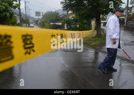 Tokyo, Japan. 26th July, 2016. A police officer stands near Yamayuri-en care center for disabled people in Sagamihara - Stock Photo