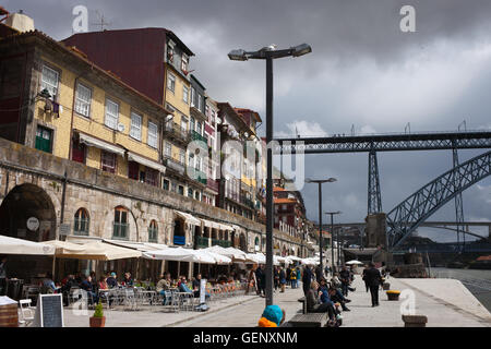 Portugal, Porto, Old Town, houses, apartment buildings, cafes at Cais da Ribeira waterfront in historic city center - Stock Photo