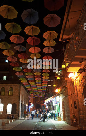 Jerusalem: colorful umbrellas hanging on Yoel Moshe Solomon Street for  the Umbrellas Street Project promoted by Jerusalem Development Authority Stock Photo