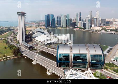 Singapore, Singapore - April 8, 2014: Singapore Skyline, Marina Bay view from Singapore Flier. - Stock Photo