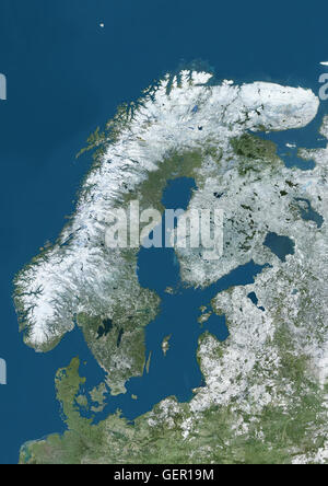 Satellite view of Northern Europe showing Scandinavia and the Baltic States in winter, with partial snow cover. - Stock Photo