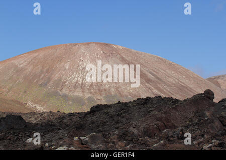 Desert stone volcanic landscape in Lanzarote, Canary Islands - Stock Photo