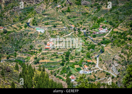 Homes on the slopes of mountains in Gran Canaria, Spain - Stock Photo