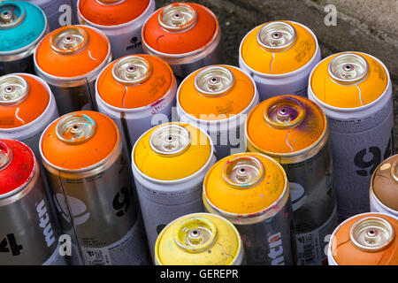 Cans of spray paint at Upfest (street art festival) in Bedminster, Bristol, UK, 23rd July 2016. - Stock Photo