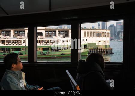 Passengers on board Start Ferry, Victoria Harbour, Hong Kong. - Stock Photo