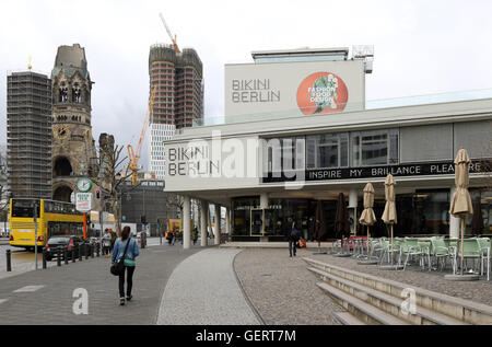 Berlin, Germany, the bikini-house and Kaiser Wilhelm Memorial Church (left) - Stock Photo