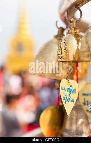 Wishing bells and the golden temple at the summit of Golden Mount in Bangkok. - Stock Photo