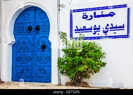A typical blue studded wooden door in Sidi Bou Said in Tunisia. - Stock Photo