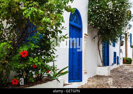 Narrow cobbled street in Sidi Bou Said in Tunisia. - Stock Photo