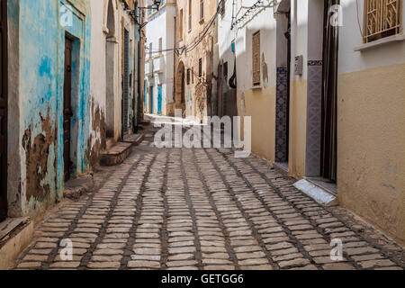 Narrow cobbled sidestreet  in the medina in Sousse in Tunisia. - Stock Photo
