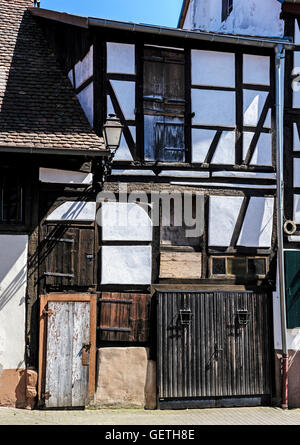 Centuries old half timbered houses in Bauxwiller in France. - Stock Photo