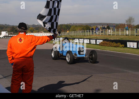 Crossing the finish line at a Vintage Sports Car Club event at Goodwood. - Stock Photo