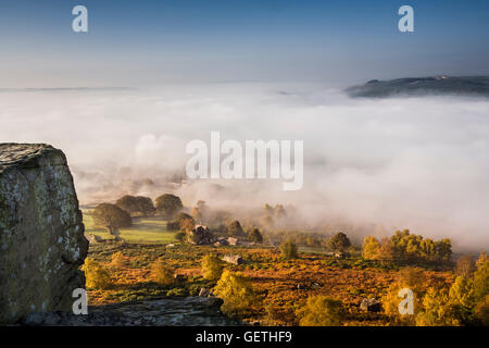 View from Curbar Edge in Derbyshire with autumn mist in the valley. - Stock Photo