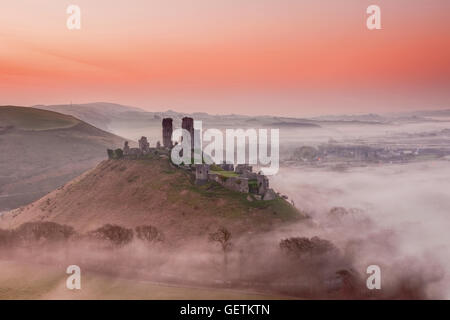 A view over Corfe Castle in Dorset. - Stock Photo