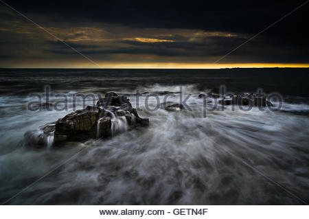 A stunning image of Ogmore beach, located along the Heritage Coast Wales, taken at sunset. - Stock Photo