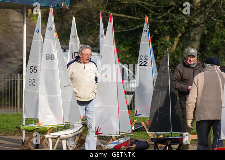 Members of the Newquay model yacht club and some of their sail boats at Trenance Lake in Cornwall. - Stock Photo