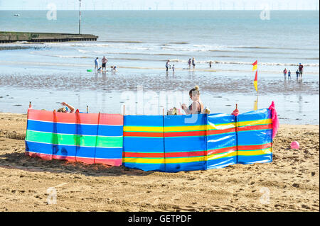 Holidaymakers on the beach at Viking Bay in Broadstairs in Kent. - Stock Photo