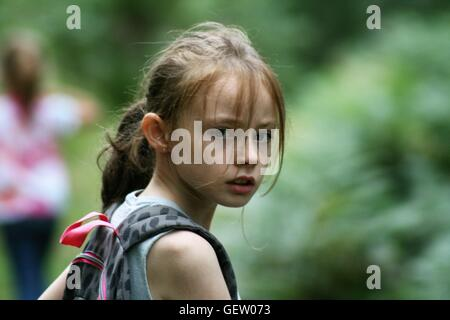 young girl looking at camera - Stock Photo