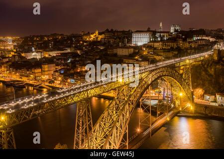 Night view of Dom Luis I bridge and city skyline, Porto, Portugal - Stock Photo
